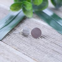 Silver - round brushed silver stud earrings made of...